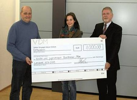 VDM Metals representatives hand over donation check